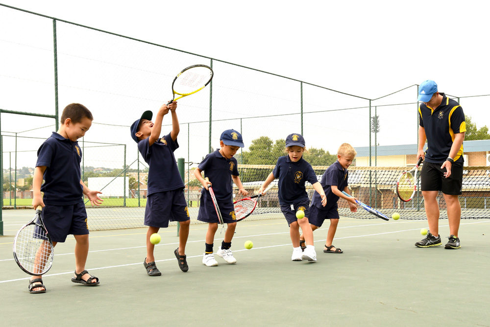 Pre-School children learn to play tennis
