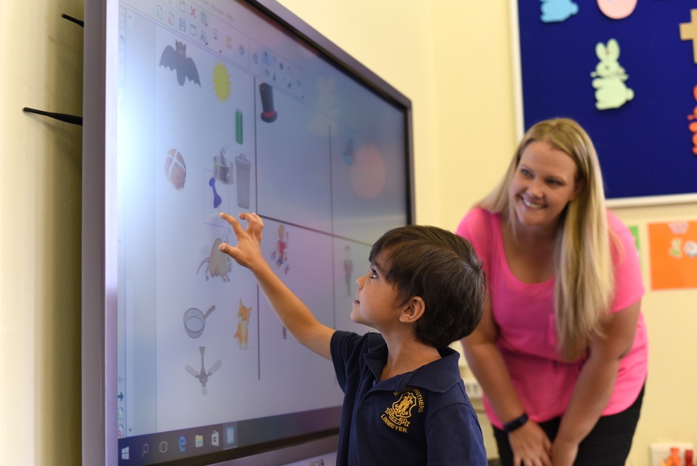 One of our Pre-Primary school boys and Mrs T Greensill learning on one of the interactive whiteboards